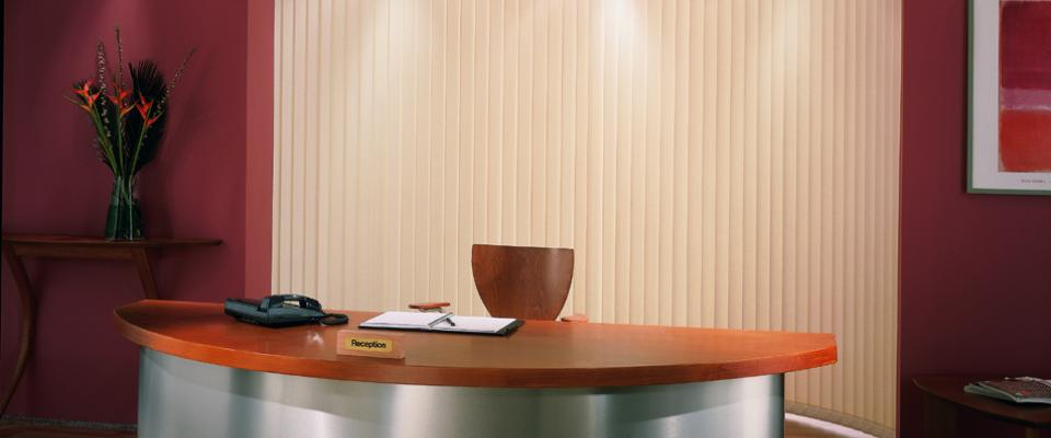Curved Headrail Vertical Blinds in Office Reception area